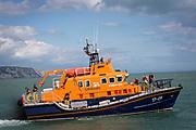 The Royal National Lifeboat Institution RNLI Dover Life boat 17-09 leaving  Folkestone Harbour, Folkestone, Kent. UK..