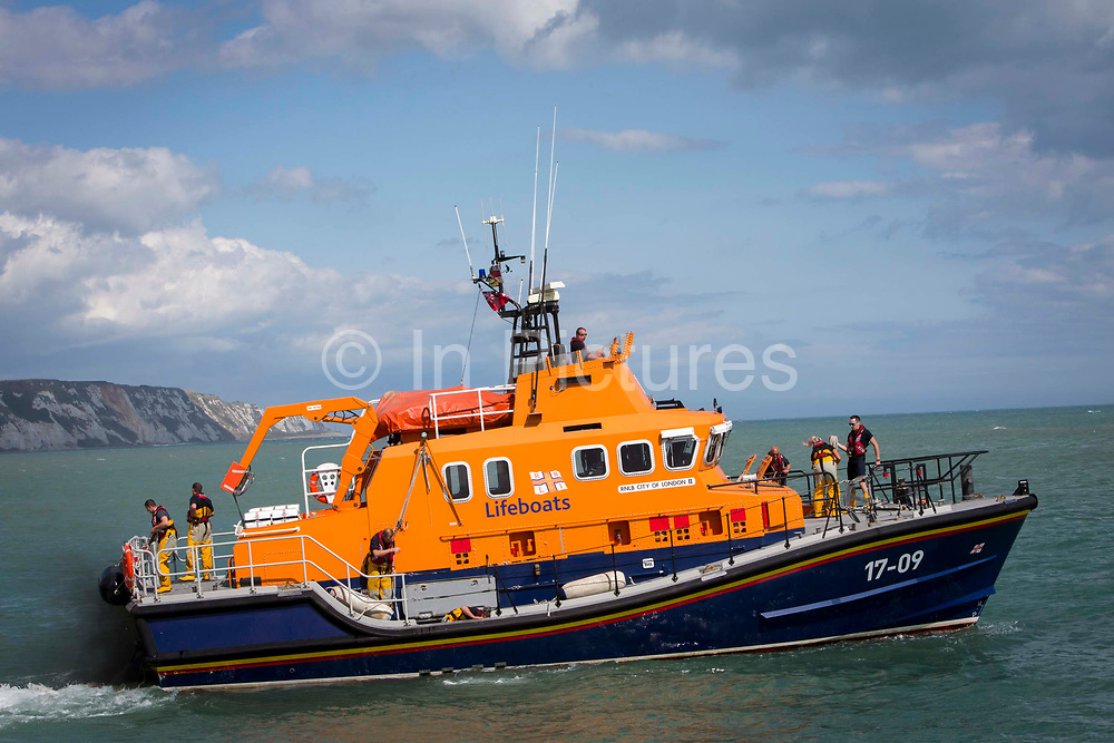 The Royal National Lifeboat Institution RNLI Dover Life boat 17-09 leaving  Folkestone Harbour, Folkestone, Kent. UK..