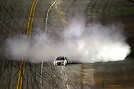 Dale Earnhardt Jr. (88) emerges from a cloud of smoke from performing a burnout after winning the NASCAR Daytona 500 auto race at Daytona International Speedway in Daytona Beach, Fla., Sunday, Feb. 23, 2014. (AP Photo/Phelan M. Ebenhack)