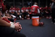 The Iraan High School football team sit in the locker room during half time of the state championship game at AT&T Stadium in Arlington, Texas on December 15, 2016. (Cooper Neill for The New York Times)