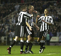 Photo. Glyn Thomas., Digitalsport<br /> Newcastle United v Vålerenga IF.<br /> UEFA Cup Third Round Second Leg.<br /> St James' Park, Newcastle. 03/03/2004.<br /> Alan Shearer (C) celebrates putting Newcastle a goal up in the first half with Michael Bridges (L) and Jermaine Jenas.