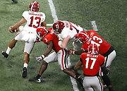 ATLANTA, GA - JANUARY 08:  Quarterback Tua Tagovailoa #13 of the Alabama Crimson Tide escapes the grasp of linebacker Roquan Smith #3 during the College Football Playoff National Championship game at Mercedes-Benz Stadium on January 8, 2018 in Atlanta, Georgia.  (Photo by Mike Zarrilli/Getty Images)