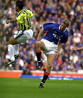 Fotball. Rangers v Fenerbahce at Ibrox, Champions league 3rd round first leg Qualifying tie<br />Pic Ian Stewart, Wednesday August 8th. 2001<br />Tore Andre Flo tries to get past Umit Ozat