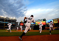 NEW YORK, NY - APRIL 16:  The New York Yankees run out onto the field before the game against the Arizona Diamondbacks on April 16, 2013 at Yankee Stadium in the Bronx borough of New York City. All uniformed team members are wearing jersey number 42 in honor of Jackie Robinson Day. (Photo by Elsa/Getty Images)
