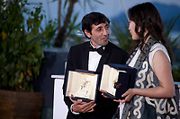 Actor Marcello Fonte winner of the Best Actor Prize for Dogman and Actress Samal Yeslyamova winner of the Best Actress award in Ayka  (The Little One) at the Award Winner's photo call at the 71st Cannes Film Festival, Saturday 19th May 2018, Cannes, France. Photo credit: Doreen Kennedy
