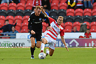 Doncaster Rovers midfileder Herbie Kane (15) and Portsmouth FC midfielder Tom Naylor (7) during the EFL Sky Bet League 1 match between Doncaster Rovers and Portsmouth at the Keepmoat Stadium, Doncaster, England on 25 August 2018.Photo by Ian Lyall.