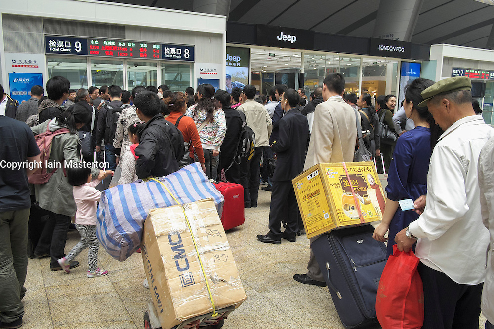 Passengers queuing in new modern Beijing South Railway Station in China