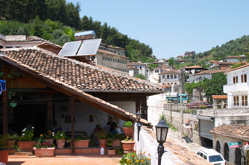 View over the roof terrace and rooftops roof tops in the lower modern part of the village. A solar panel and water heating container on the roof. Berat lower town. Albania, Balkan, Europe.