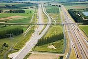 Nederland, Gelderland, Valburg-Elst, 28-06-2006; spooremplacement Betuweroute: links de opstelsporen, rechts het hoofdspoor van de goederenspoorlijn (naar het Oosten, richting Duitsland), het geheel zal worden gebruikt voor de overslag van containers, het CUP (Container Uitwissel Punt rechts de autosnelweg A15; op deze lokatie zou in de toekomst het multimodaal transport centrum (MTC) gebouwd moeten worden; vrachtvervoer, milieu, transport, infrastructuur, infrabundel, verkeer en vervoer, goederen spoorlijn, mobiliteit, planologie; ook (lucht)foto's van de bouwfase en andere (lucht)foto's van deze lokatie; deel van de serie Panorama Nederland luchtfoto (toeslag aerial photo (additional fee required .foto Siebe Swart / photo Siebe Swart