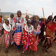 Groups of young girls and men dance around the boma showing off their moves and outfits.