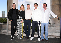 Robbie Williams, Ayda Field, Dermot O'Leary, Louis Tomlinson and Simon Cowell attending the X Factor photocall held at Somerset House, London. Photo credit should read: Doug Peters/EMPICS