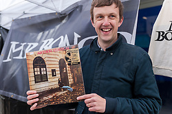 © Licensed to London News Pictures. 16/04/2016. London, UK. A buyer celebrates finding a rare LP. Fans of vinyl visit record shops in and around Berwick Street in Soho today, on Record Store Day, a worldwide celebration of analogue music and music to be listened to from a physical format. Photo credit : Stephen Chung/LNP