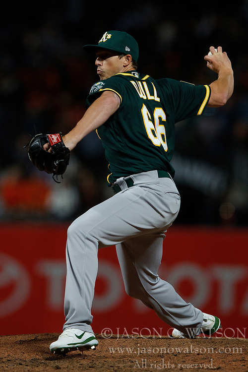 SAN FRANCISCO, CA - JULY 13: Ryan Dull #66 of the Oakland Athletics pitches against the San Francisco Giants during the seventh inning at AT&T Park on July 13, 2018 in San Francisco, California. The San Francisco Giants defeated the Oakland Athletics 7-1. (Photo by Jason O. Watson/Getty Images) *** Local Caption *** Ryan Dull