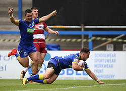 Warrington Wolves Declan Patton scores his sides fourth try of the game during the Ladbrokes Challenge Cup, quarter final match at the Halliwell Jones Stadium, Warrington.