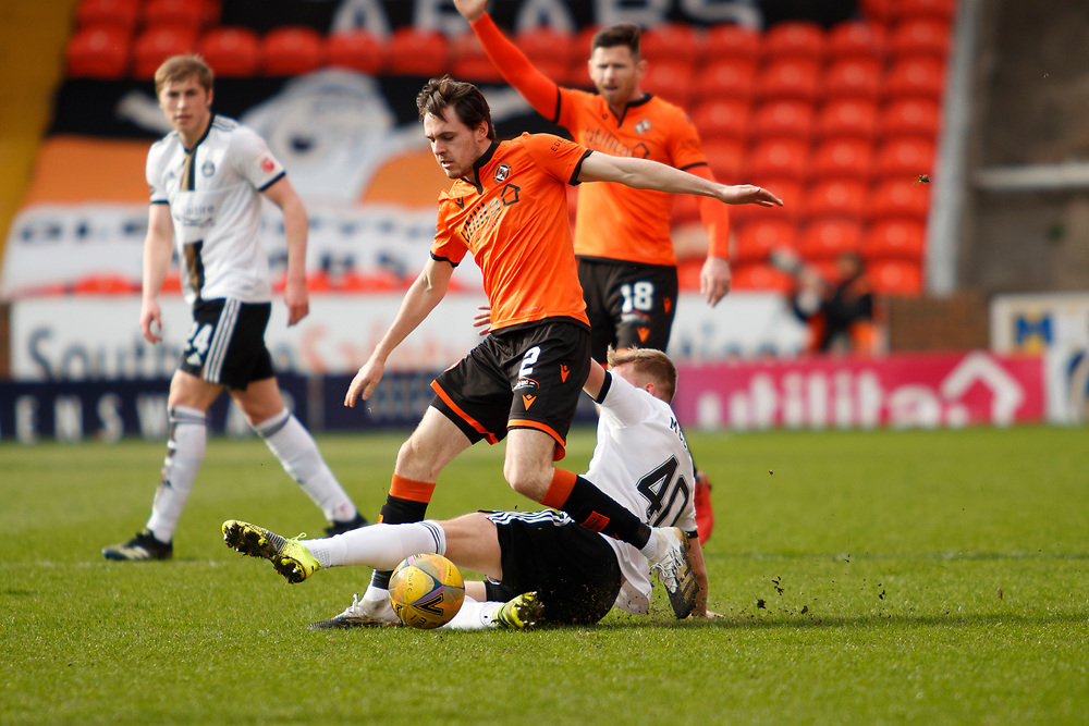 DUNDEE, SCOTLAND, MARCH 20, 2020:  Dundee Utd V Aberdeen FC Ladbrokes SPFL Premiership fixture at Tannadice Park, Dundee.<br /> <br /> Pictured: Liam Smith (Dundee Utd Defender) and Ross McCrorie (Aberdeen FC Midfielder on Loan from Rangers)<br /> <br /> <br /> (Photo: Newsline Media)