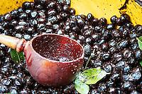 Black olives shine in dish, open air market, L'Isle sur la Sorgue, France
