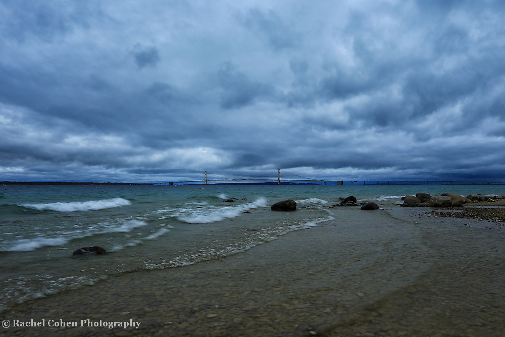 """""""Stormy Straits""""<br /> <br /> Beautiful dark and moody storm clouds envelope the straits of Mackinac with a view of Mackinac Bridge in the distance!! A wonderful waterscape and cloudscape!!<br /> <br /> Mackinac Bridge by Rachel Cohen"""