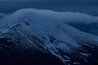 Cloudy sky and fresh snow on Mount Smrecinsky vrch (2066m asl). Western Tatras, Slovakia. June 2009. Mission: Ticha