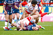 Leeds Rhinos hooker Matt Parcell (9) is tackled during the Betfred Super League match between Hull Kingston Rovers and Leeds Rhinos at the Lightstream Stadium, Hull, United Kingdom on 29 April 2018. Picture by Simon Davies.