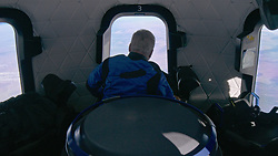 Handout photo dated October 13, 2021 of William Shatner looks out of the New Shepard windows on NS-18. Hollywood actor William Shatner has become the oldest person to go to space as he blasted off aboard the Blue Origin sub-orbital capsule. The 90-year-old, who played Captain James T Kirk in the Star Trek films and TV series, took off from the Texas desert with three other individuals. Mr Shatner's trip on the rocket system - developed by Amazon.com founder Jeff Bezos - lasted about 10 minutes. Photo by Blue Origin via ABACAPRESS.COM