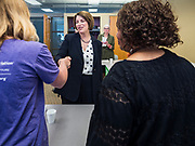 15 JULY 2019 - DES MOINES, IOWA: Senator AMY KLOBUCHAR (D-MN) greets people as she arrives at a roundtable about senior citizen issues in Des Moines. Sen. Klobuchar hosted a roundtable on issues important to older Americans at a community center in Des Moines. Klobuchar is running to be the Democratic candidate for President in the 2020 election. Iowa hosts the first event of the Presidential election cycle. The Iowa Caucuses are on February 3, 2019.         PHOTO BY JACK KURTZ