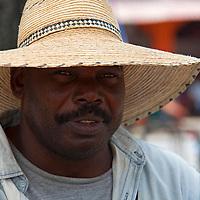 Central America, Cuba, Santa Clara. Cuban man in hat.