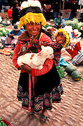 PERU, HIGHLANDS, MARKETS Pisac; mother, child and lamb