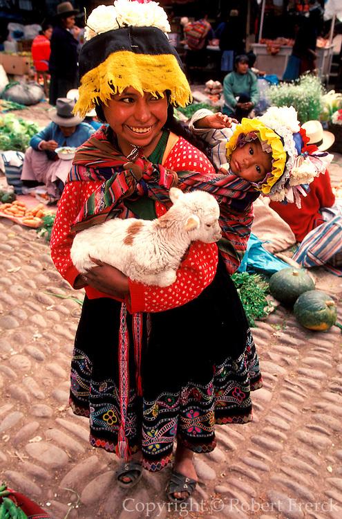 PERU, HIGHLANDS, MARKETS Pisac; mother, child and lamb