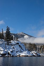 """""""Snowy Point on Lake Tahoe 2"""" - This snowy point was photographed from a boat on the East shore of Lake Tahoe. Rubicon Peak can be seen in the background."""