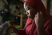 Aisha B, 15, makes a prayer cap inside her room in a tent at an IDP camp in Maiduguri, Nigeria, April 19, 2019. Aisha B was abducted by her older brother who joined Boko Haram in 2015 in Banki District, and spent three and half years in Sambisa Forest. At the age of 13, she was forced to marry a 45-year-old commander who already had three wives and three girlfriends. She was rescued by the Nigerian Army that attacked their enclave.