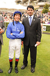 Left to right, FRANKIE DETTORI top trainer SAEED BIN SUROOR at the third day of the 2010 Glorious Goodwood racing festival at Goodwood Racecourse, Chichester, West Sussex on 29th July 2010.