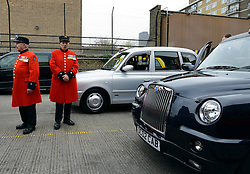 © Licensed to London News Pictures. 02/05/2012. London, UK. Two Chelsea Pensioners wait near the cabs.  London Mayor,Boris Johnsonis joined bycomedian Al Murrayto wave off an army ofWWII veterans who are embarking on an iconic trip to the Netherlands, via a convoy of black cabs.The London Taxi Benevolent Association for the War Disabled has organised a trip for 160 WWII veterans to travel to Holland in 80 London Black Cabs. The veterans, mostly aged between 85 and 94, will start their journey from London today 2nd May 2012 and will be visiting sites of importance from WWII and taking part in Dutch Liberation Day celebrations as guests of honour of the Dutch Royal Family.. Photo credit : Stephen Simpson/LNP