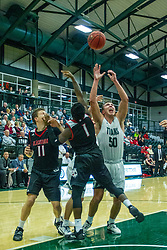 BLOOMINGTON, IL - November 12: Charlie Bair defended by Javon Stovall during a college basketball game between the IWU Titans  and the Blackburn Beavers on November 12 2019 at Shirk Center in Bloomington, IL. (Photo by Alan Look)