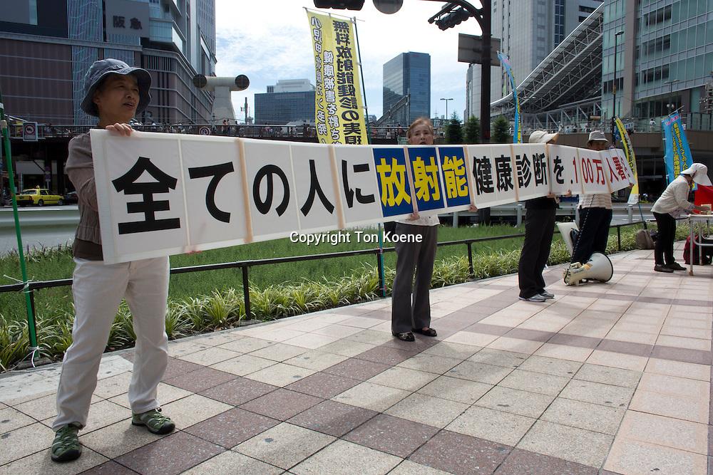 protest against nucliair energy in japan