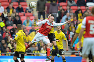 Fleetwood Town's Iain Hurne is challenged for a header by Burton Albion's Phil Edwards . Skybet football league two play off final match , Burton Albion v Fleetwood Town at Wembley Stadium in  London on Monday 26th May 2014.<br /> pic by John Patrick Fletcher, Andrew Orchard sports photography.