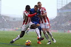 Everton's Cenk Tosun (centre) battles for the ball with Stoke City's Kurt Zouma and Ryan Shawcross (left)