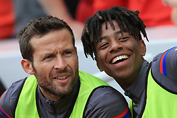 19th August 2017 - Premier League - Liverpool v Crystal Palace - Sullay Kaikai of Palace (R) laughs and jokes with teammate Yohan Cabaye - Photo: Simon Stacpoole / Offside.