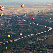 A view from the air and from a hot air ballon flying high over Albuquerque during the city's annual balloon fiesta