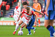 James Coppinger of Doncaster Rovers (26) closely marked by Billy Bingham of Gillingham (16) during the EFL Sky Bet League 1 match between Doncaster Rovers and Gillingham at the Keepmoat Stadium, Doncaster, England on 20 October 2018.