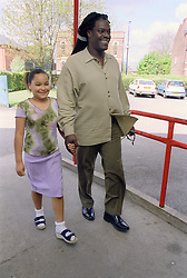 Single father taking young daughter to primary school,