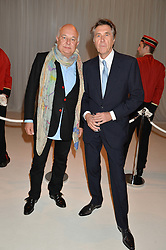 Left to right, ROLF SACHS and BRYAN FERRY at a dinner hosted by Cartier in celebration of The Chelsea Flower Show held at The Hurlingham Club, London on 19th May 2014.