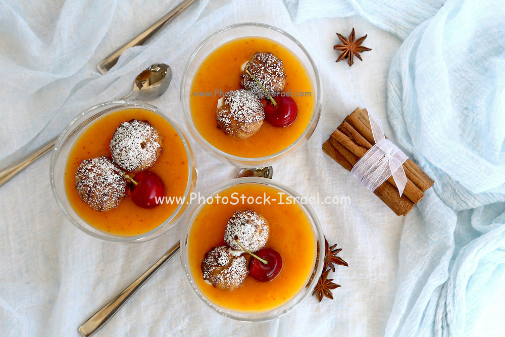 Cream puff and fruit smoothy dessert decorated with anis and vanilla This image has a restriction for licensing in Israel