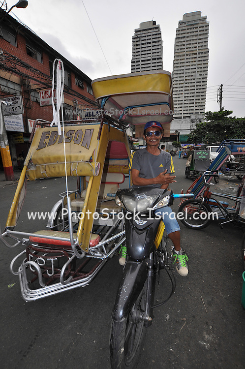 Manila, Philippines, a motorcycle taxi with driver