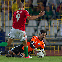 Goalkeeper Israel's Dudu Aouate (R) saves a goal attempt by Hungary's Adam Szalai (L) during a friendly football match Hungary playing against Israel in Budapest, Hungary on August 15, 2012. ATTILA VOLGYI