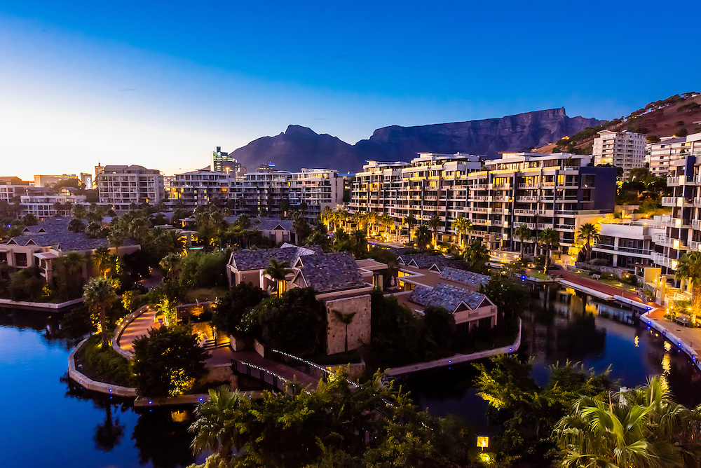 View from balcony at sunrise with apartment buildings and Table Mountain in background, Hotel One&Only Cape Town, V&A Waterfront, Cape Town, South Africa.