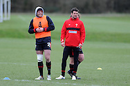 Jamie Roberts of Wales (l) and Mike Phillips look on.Wales rugby team training at the Vale, Hensol near Cardiff, South Wales on Tuesday 12th March 2013.  the team are training ahead of the final RBS Six nations match against England this weekend. pic by  Andrew Orchard, Andrew Orchard sports photography,