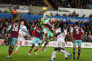 Adrian, the West Ham Utd goalkeeper fumbles the ball as his teammate James Collins tries to head clear.Barclays Premier league match, Swansea city v West Ham Utd at the Liberty Stadium in Swansea, South Wales  on Sunday 20th December 2015.<br /> pic by  Andrew Orchard, Andrew Orchard sports photography.