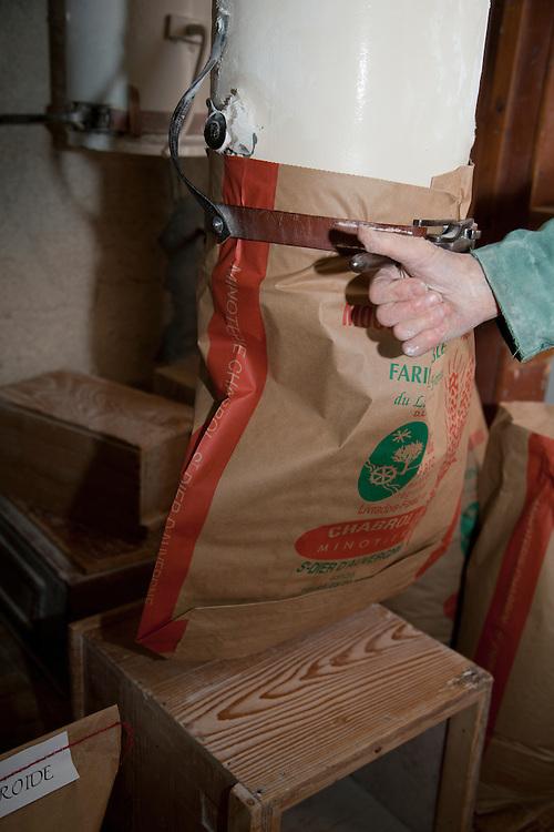 Old traditional flour mill, filling up bags with flour, PRN the Livradois-Forez, St. Dier d'Auvergne, Auvergne, France