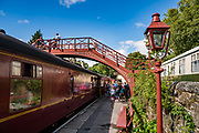 Goathland station was the setting for fictional Hogsmeade Station for the Hogwarts Express in Harry Potter films. From Grosmont we took a steam-hauled train through North York Moors National Park to Pickering on the North Yorkshire Moors Railway, in North Yorkshire county, England, United Kingdom, Europe. England Coast to Coast hike day 12 of 14. [This image, commissioned by Wilderness Travel, is not available to any other agency providing group travel in the UK, but may otherwise be licensable from Tom Dempsey – please inquire at PhotoSeek.com.]
