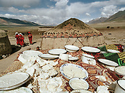 "Djer Qabtshal summer camp: ""Kurut"" cheese drying in the sun for a few days, making it hard as stone and easy to preserve through winter, when yaks do not give any milk.<br /> <br /> Adventure through the Afghan Pamir mountains, among the Afghan Kyrgyz and into Pakistan's Karakoram mountains. July/August 2005. Afghanistan / Pakistan."